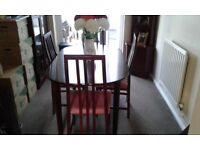 For sale extending dining room table with 4 chairs, corner display unit and a display unit