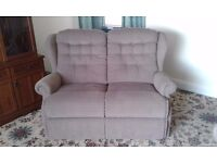 Two seater sofa with two recliners