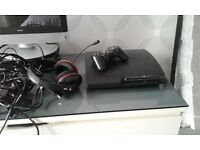 PlayStation 3 with games controller and headset