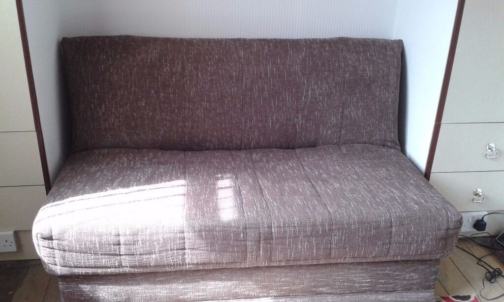 """Sofa Bed AFramein Leicester, LeicestershireGumtree - Sofa Bed AFrame Brown/cream spec upholstery Slumberland label on matress Also comes with two pillow cushions as pictured. Sofa is 57"""" wide and pulls out to a standard Double size bed In very nice clean condition. No rips or pulls on upholstery...."""
