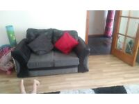 Black and grey sofa for sale will b ready to gonext week year and a half old