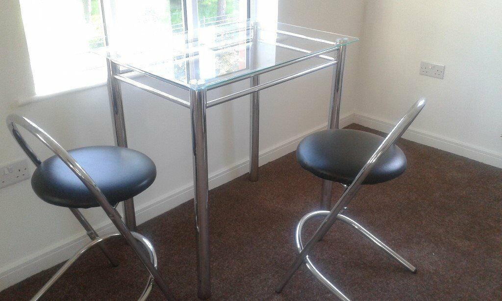 Solid Glass Chrome Table with 2 stoolsin Morpeth, NorthumberlandGumtree - Solid Glass Chrome Table with 2 stools. Great condition. Approx 3ft x 2ft. Collection Only