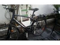 B twin front disc suspension hybrid bike good condition with extrasready to ride away