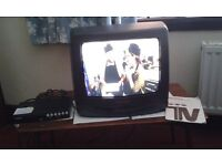 """Grundig 14"""" colour TV (GT1402) with freeview box, remote control and instructions"""