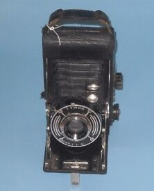 Vintage folding camera and case, for decorative purposes only