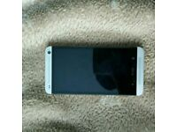 HTC One M7 32 GB (3 carrier) w/ 2 cases