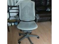 Multi adjustable office chair. Grey on wheels.