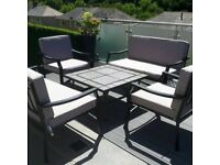 Five piece patio set with cushions, table also a fire pit,must collect