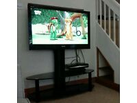 "42"" Toshiba TV and black glass stand"
