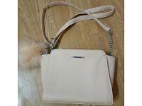Blush pink small handbag with pom pom