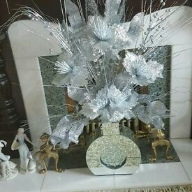 Silver flower arrangement with mirrored vase