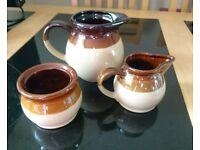 Brown and cream tableware trio