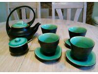 Ceramic teapot, 4 cups, 4 saucers, sugar bowl and spoon