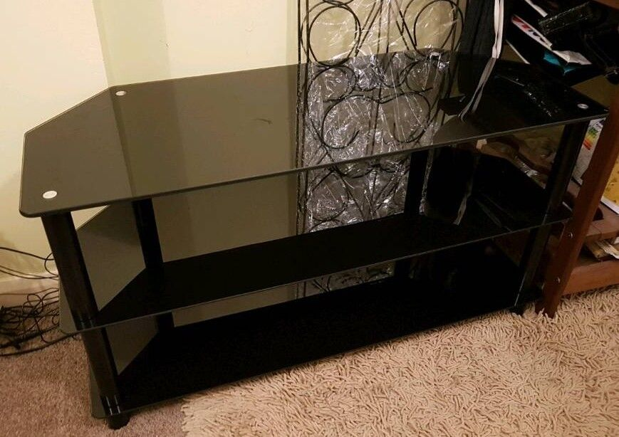 Large Black Glass TV Stand had 55 TV on it