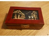 Chinese jewelry box with cork carving