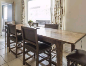 Dark oak dining table / 6 oak and leather chairs