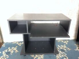 Black computer office desktop table on wheels or ideal storage for music equipment