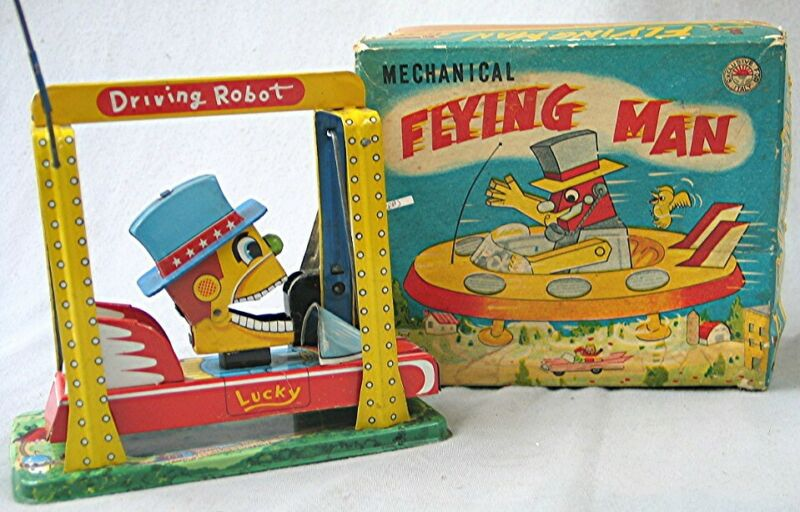 Vintage Tin Wind Up -- Mechanical Flying Man - Driving Robot -- with the Box