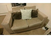 2 seater couch with cushions