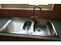 Double kitchen sink, mixer taps and draining board