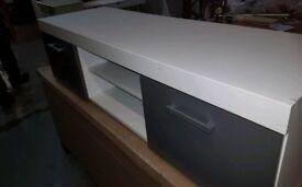 A brand new white x grey 2 door tv.