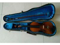 Half size violin and case