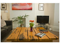 A sophisticated grnd flr 1 bedroom holiday apartment with private parking and close to the station