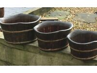 Set of three wooden planters
