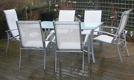 7 Piece Patio Table & Chairs. Excellent Condition. 4 Stackable chairs. 2 Reclining Chairs + Table
