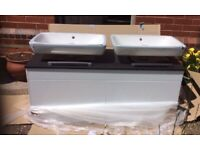Wall mounted double vanity unit with twoVitra countertop sinks and tap