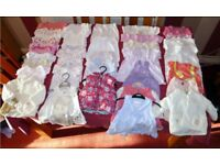 Assorted baby clothes.