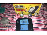 2DS console with games