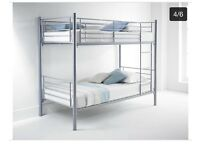 Silver bunk beds with mattresses as good as new