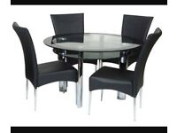 Black glass and chrome dining table and chairs harveys