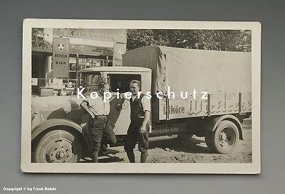 Foto Likör LKW und Emailschilder um 1925