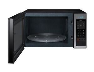 SMALL MICROWAVE FOR SALE... HARDLY USED