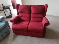 Nearly new 2 seater sofa and easy chair in a cherry red . Ideal for a small flat.