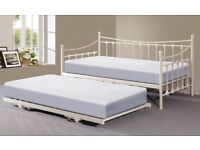 Cream metal day bed with trundle and matresses