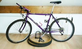 Lightweight mountain bike, spare road tyres and D-lock