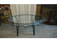 Glass coffee table with metal base