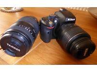 Nikon D5100 digital camera, 18-55 auto lens + 70-300 Tamron manual lens + case, strap + charger
