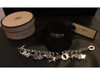LINKS OF LONDON SILVER CHARM BRACELET WITH 14 CHARMS £90.