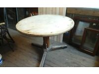 Large round pine dining table