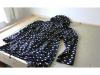 light weight duck print shower proof coat in black and white with hood