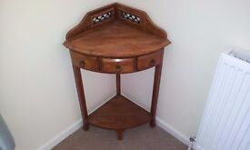 Corner table with three draws...solid wood pine colour
