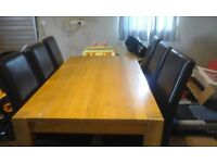 6 Foot solid oak table and 6 chairs