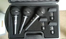 3 matching microphones with clips and cased