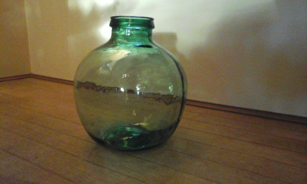"""Vintage Retro Green Glass VIRESA Indoor/Outdoor Garden Bottle Carboyin Tiptree, Essex - Vintage Retro Green Glass VIRESA Indoor/Outdoor Garden Bottle Carboy Vintage large green glass planter clearly marked VIRESA Great feature planter for inside / outside. Only used indoors Measures 14""""high and 40""""round approx. EXCELLENT condition..."""