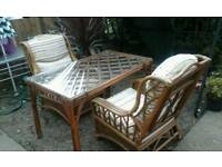 Two cane chairs and a table feel free to contact me