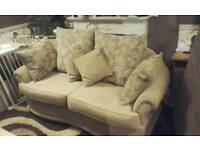 Beige two seater sofa feel free to contact me
